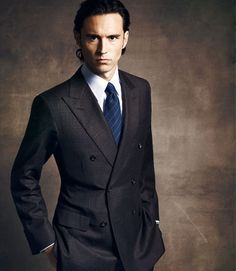 charcoal sets off the blue tie perfectly