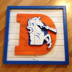 Old School Denver Broncos logo wall art made from pallet wood on Etsy, $225.00
