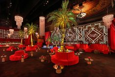 <p> Lush green palms contrasted the red velvet seating and floor-to-ceiling red velvet drapes at the SAG awards' official after-party...