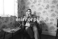 Ronnie Kray sat at home after helping police inquiries into the Blind Beggar Pub shooting. Ron Kray, The Krays, Mafia Gangster, East End London, Twin Brothers, Yesterday And Today, Rare Photos, Investigations, Photo Sessions