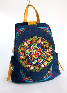 A personal favourite from my Etsy shop https://www.etsy.com/sg-en/listing/258024156/boho-embroidery-hmong-bag-denim-backpack