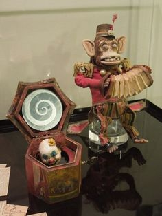 These two freaky toys, an awesomely creepy wind-up monkey and nightmare-inducing evil clown jack-in-the-box, are both screen-used props from the recent supernatural horror film The Conjuring.