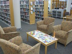 LIBRARY CARDS  cover a library table.