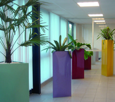 Triangle Planters in a variety of colours http://www.livingreendesign.com/category/106-triangle.aspx