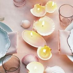 Gorgeous candle idea. Collect shells at the beach, melt old candles from the goodwill or home, and try in the bathroom :) or for patio/summer gathering