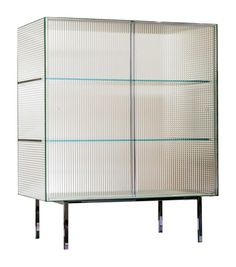 Commodore Glas Italia Sideboard Commodore designed by Piero Lissoni for Glas Italia is a sideboard realized in crystal printed stripes or squares, toughened and glued at 45°, with mirror finish. The legs are in chromium plated metal, while the sliding doors are placed in plexiglass guides.