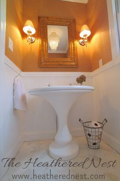 DIY Herringbone tile, and 1940's cast iron pedestal sink upcycle, burlap/grasscloth wallpaper.   http://www.heatherednest.com/2014/10/and-well-never-be-royals.html