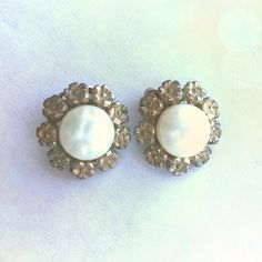 Vintage Marvella flower & pearl clip on earrings Vintage Marvella flower & pearl clip on earrings. Pearl center surrounded by little flowers in a goldish Brad's finish. Tarnished a bit. Not sure of age. Vintage Jewelry Earrings