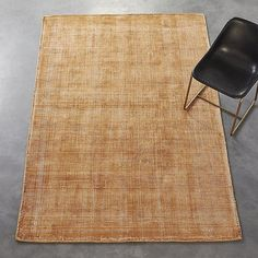 Shop scatter camel rug.   On-trend color, texture and intricate design details make this rug truly one of a kind.  In a very elaborate process, rug starts as a white base woven on a traditional loom.