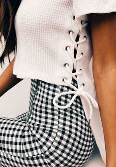 Cute white laced top with black and white checked pants.