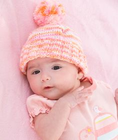 Welcome a newborn into the world with a beautiful knit hat pattern. It's not hard to learn how to knit a hat that is sure to put a smile on your face every time you see your darling child in it.