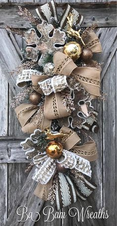 Rustic Christmas. Christmas Wreath, Christmas Swag, Christmas Door Hanging, Holiday Wreath, Holiday Swag, Winter Wreath, Winter Swag Im Dreaming Of A Rustic Christmas.....fine details, lush decor.....this swag is so Stunning ~ youll be saying I want more. Now make your door/entry/mantel dazzling with this gorgeous swag!!! Made with stunning holiday sprays & designer ribbons, beautiful ornaments and radiant style~ this swag is so charming and will turn your home into an invitin...