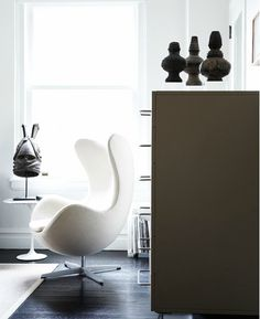 Arne Jacobsen Egg Chair With African Antiques.