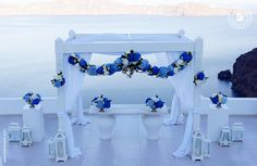 Luxury wedding at Dana Villas, 2014 Wedding of Miss Cici Yan Santorini, July 22nd, 2014 Decorations 2 festoons 2 hanging arrangements flower chandelier 2 registrar table arrangements 2 pedestal arrangements Wedding venue: Dana Villas Wedding planner: Julia Nicolaou