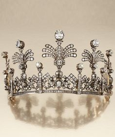 AN ANTIQUE DIAMOND TIARA, MID 19TH CENTURY. Designed as a graduated series of openwork articulated panels of stylised Greek key and foliate scrolls, surmounted by five graduated stylised fan palm sprays, set with cushion-shaped, circular- and rose-cut diamonds. #Antique #Tiara