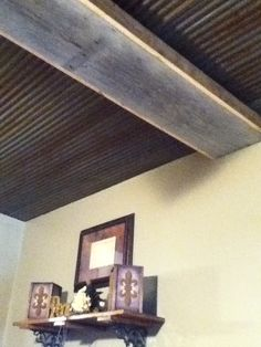 Tin ceiling & old barn wood beam..