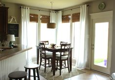 """cute breakfast nook (love the bamboo blinds with the white curtains, light fixture, rug, etc)- paint colour is Sherwin Williams  """"Balanced Beige"""" from decorchick.com"""