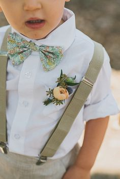 It would be cute if the flower girl or the bridesmaid dresses were floral and his bow tie was the same as their dresses.