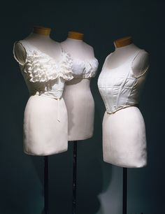1900-1910 bust-improver brassieres from http://www.metmuseum.org/toah/works-of-art/1982.316.8