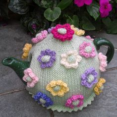 Craft a cure for cancer free tea cosy patterns: Flower tea cosies Knitted Flower Pattern, Tea Cosy Knitting Pattern, Tea Cosy Pattern, Knitted Flowers, Flower Patterns, Crochet Patterns, Knitting Patterns, Scarf Patterns, Knitting Tutorials