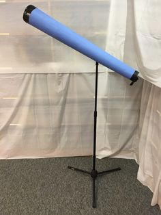 DIY telescope made from a microphone stand, rolled up poster board, and duct tape. (I put black paper in the top opening and cut stars into it)