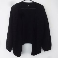 Black Knit Petite Cardigan Pre-Loved. Has pilling and shows signs of wear. Has been priced accordingly. Sleeves are full length. Tag size Large, best fits Medium. May be oversized on a size Small. 50% Acrylic. 30% Wool. Polyamide blend. Brand is not Brandy Melville, listed for exposure. Brand is HM. NO TRADE. NEGOTIATIONS ONLY THROUGH THE OFFER BUTTON. Comments asking to trade or negotiation through comments will be ignored Brandy Melville Sweaters Cardigans