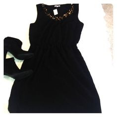 LBD Beautiful black dress from Gap. Sleeveless polyester fully lined with gold sequin detailing at v neck. Elastic waist with side pockets. NWT GAP Dresses Mini