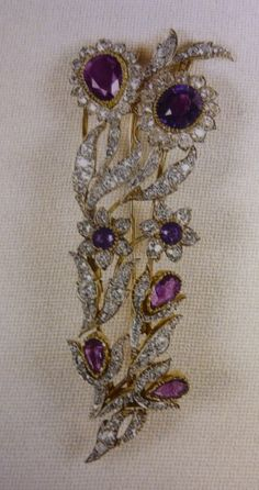 The Queen`s Amethyst Bouquet brooch, an attractive brooch set in gold with diamonds & seven amethysts, usually worn on lilac or purple outfits.
