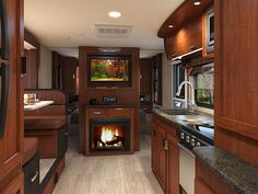 Lance 2295 Travel Trailer - Standard exterior kitchen and available interior fireplace set the 2295 apart. Small Travel Trailers, Rv Trailers, Travel Trailer Floor Plans, Accordion Doors, Rental Search, Fireplace Set, Overhead Storage, Rv Rental, Shower Rod