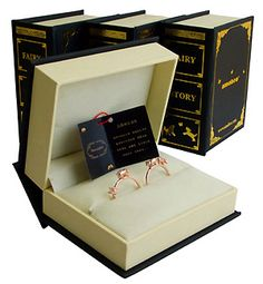 story rings. comes in book formed boxes