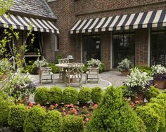 Patio with lovely striped awnings.     The Enchanted Home: Join me in the English countryside for the weekend!