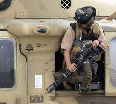 ARMY Pave Hawk flight engineer inspects a minigun Military Helicopter, Military Weapons, Military Life, Military Aircraft, Big Guns, Military Equipment, War Machine, Special Forces, Tactical Gear