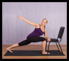 A modified version of the Revolved Side Angle yoga pose using a chair.