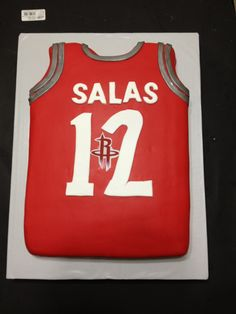 HOUSTON ROCKETS cake matching babyshower theme. the last name of baby & the year baby will be born in.