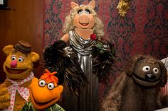 Credit: Jacquelyn Martin/AP Miss Piggy is joined by, from left, Fozzie Bear, Scooter and Rowlf