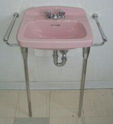 1950's pink console sink with towel bars.  Sweet!