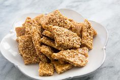 Crunchy sesame brittle, so easy to make! With sesame seeds, sugar, and honey from Simply Recipes Sesame Brittle Recipe, Brittle Recipes, Healthy Recipes, Healthy Snacks, Cooking Recipes, Simply Recipes, Sweet Recipes, Candy Recipes, Dessert Recipes
