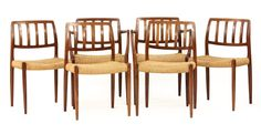 A set of six Danish rosewood Møller 83 and 66 dining chairs, designed by Niels Møller for J L Møller, each with woven cord seats