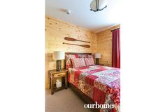 There are two additional bedrooms upstairs on the main level, themed with the same red and blue nautical colours as the exterior.   http://www.ourhomes.ca/articles/build/article/viceroy-cottage-becomes-recharging-retreat?full=true#sthash.Rnu855dl.dpuf