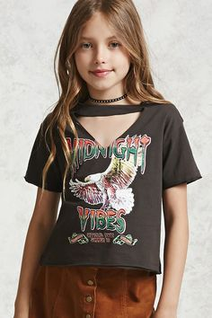 """Forever 21 Girls - A knit tee with front and back graphics such as; """"Midnight Vibes"""", """"Official Tour Summer '91"""", a flying eagle, and """"Sold Out"""" tour dates. This tee features a ribbed crew neck, V-cutout, short sleeves, and raw-cut rolled trim."""