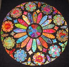 Rose Windows for Quilters, by Angela Besley..