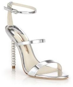 "Strappy metallic leather sandal with crystal heelCrystal-trimmed heel, 4.75"" (120mm)Metallic leather upperOpen toeAdjustable ankle strapLeather lining and solePadded insoleMade in Brazil"