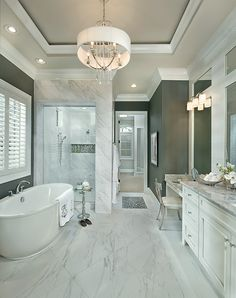 Stunning new bathroom with free standing tub and walk in shower in Liberty Township Luxury Designer Home.  See more of this model's pics at http://arhomes.us/ohiomodelhome1