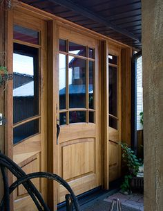 This Mahogany-crafted double entry door is a creative mix of a modern and vintage design with a curved lite and sidelite cased by mirror glass. Double Entry Doors, Front Entry, Door Entry, Metal Bunk Beds, Steel Frame Construction, Door Trims, Home Reno, Exterior Doors, Rustic Style