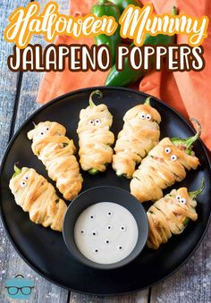 A fun and easy appetizer or snack, these Halloween Mummy Jalapeño Poppers are tasty, cheesy and just a bit spooky! Finger Food Appetizers, Easy Appetizer Recipes, Appetizer Dips, Yummy Appetizers, Yummy Snacks, Finger Foods, Jalapeno Popper Recipes, Jalapeno Poppers, Poppers Recipe