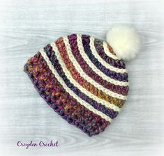 Crochet this gorgeous chunky winter Spectrum Beanie using only the double crochet and slip stitches! Crocheted with Lion Brand Thick and Quick!