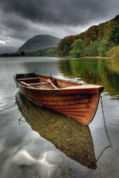 Autumn on Buttermere in the English Lake District - Phil Jones, UK photography {row boat beneath stormy clouds} Old Boats, Small Boats, Boat Art, Wooden Boats, Wooden Row Boat, Wooden Sailboat, Boat Plans, Boat Building, Building Plans
