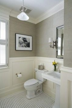 black and white bathroom floor tiles.  Greige grasscloth + beadboard + basket weave.