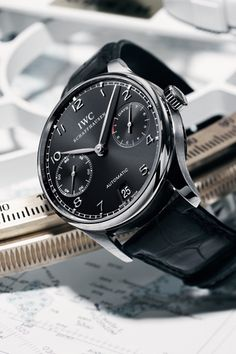 IWC Schaffhausen. I will take the white-face one to go, Thanks!