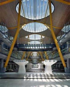The ceiling at Barajas Madrid International airport (T4), designed by Richard Rogers, consists of 200,000 m2 of gently curved laminated bamboo laths, and is therefore the largest industrial bamboo project in the world. To comply with the stringent fir